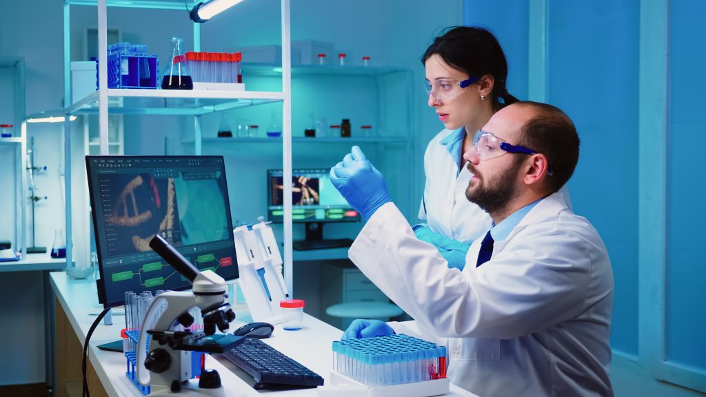 two scientists testing DNA genetics in a lab