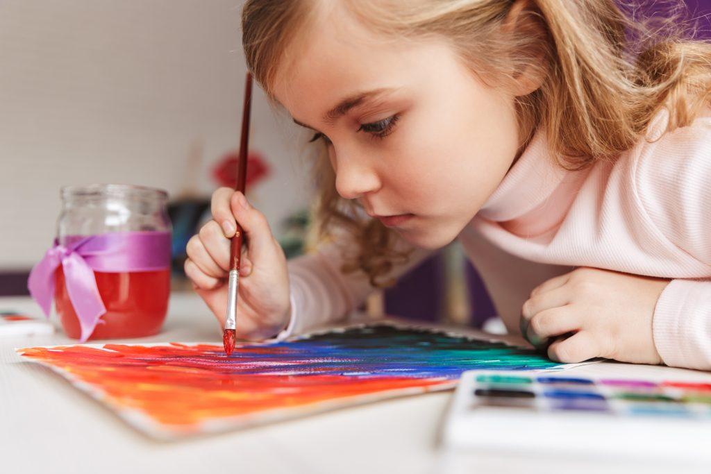 little girl painting a watercolour picture