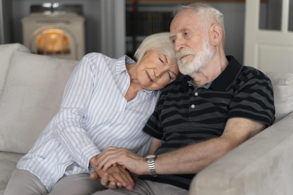 old couple with alzheimer's diseases comforting each other