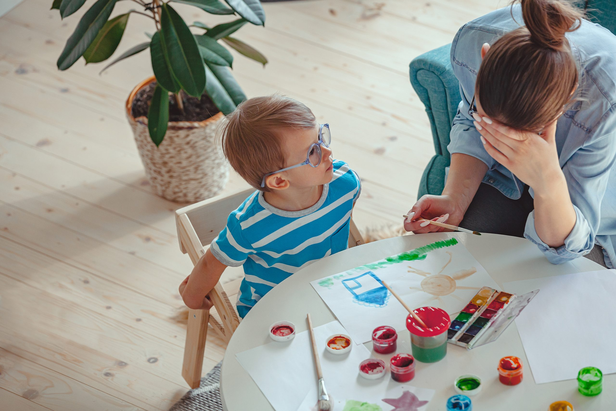little boy and his mother frustrated at his art